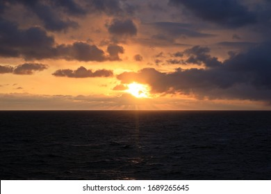 View of the sunset from the ship underway and in the port. Colorful views of the surface of the water and the sky with clouds.