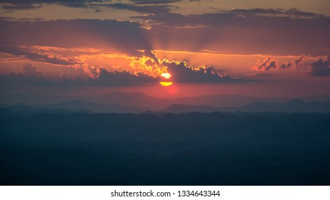 View of sunset taken from Lom Sak cliff, Phu Kradueng National Park, Loei Province