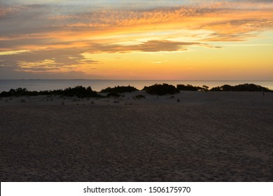 View of the sunset from the top of the sand dune at Jockeys Ridge State Park.