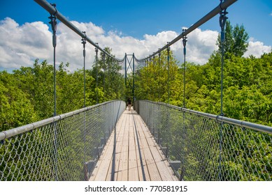 View of suspension bridge in Collinwood, Ontario during the summer time