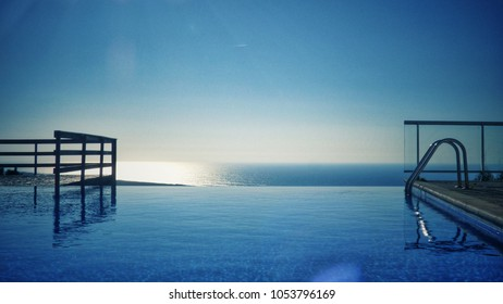 View of swimingpool with sea in background