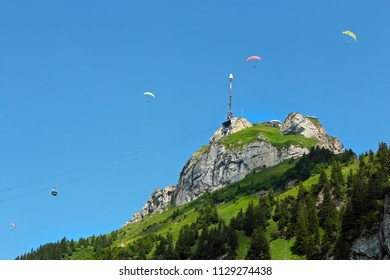 "view of the Swiss mountain ""Hoher Kasten"" with paragliders"