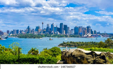 View of Sydney from across the harbour. Afternoon, panorama, cloudy sky's, cityscape