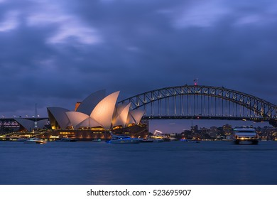 View of  Sydney Opera House And Harbour Bridge Sydney Australia at sunset  from Mrs Macqurie's Chair.NOV 28,2016. Sydney Opera House is modern building, well known worldwide.