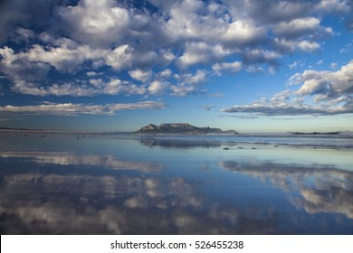 view of table mountain from bloubergstrand in  cape town south africa