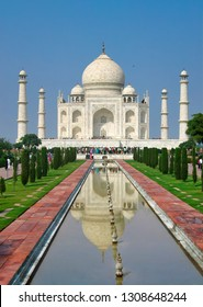 View of Taj Mahal Against Blue Sky and Reflection in the Water Pool
