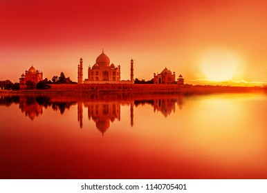 view of Taj Mahal during sunset reflected in the Yamuna river, in Agra , Uttar Pradesh, India