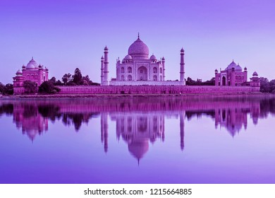 view of Taj Mahal during sunset reflected in the Yamuna river, in Agra , Uttar Pradesh, India