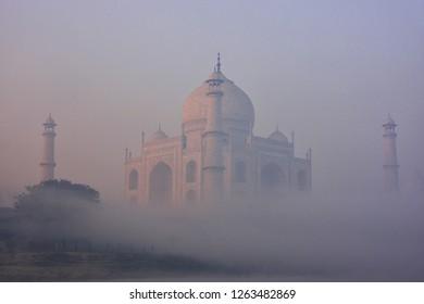 View of Taj Mahal in early morning fog, Agra, Uttar Pradesh, India. Taj Mahal was designated as a UNESCO World Heritage Site in 1983.