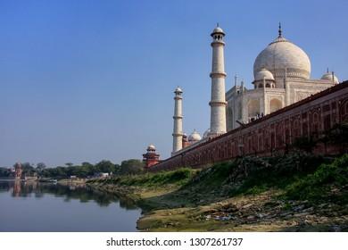 View of Taj Mahal from Yamuna river, Agra, Uttar Pradesh, India. Taj Mahal was designated as a UNESCO World Heritage Site in 1983.