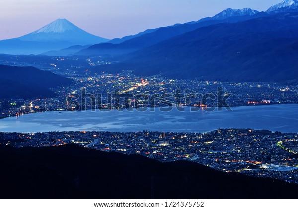 View from Takabocchi highlands, Nagano, Japan. Mt. Fuji and lake Suwa.