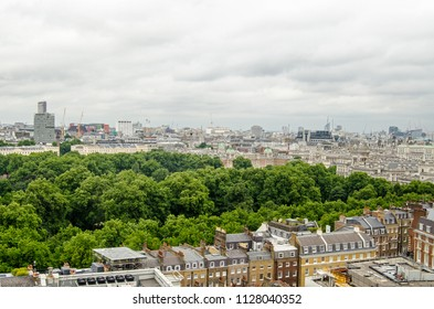View from a tall building of the trees of St James' Park in the middle of Westminster, London.  To the right are the Government ministries of Whitehall.