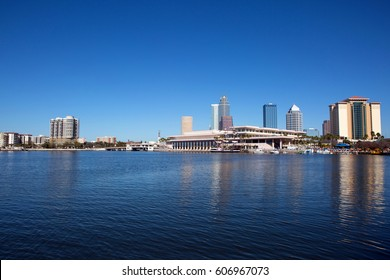 View of the Tampa convention center and the city skyline from across the Hillsborough River. The Tampa Convention Center is publicly owned and operated by the city of Tampa.