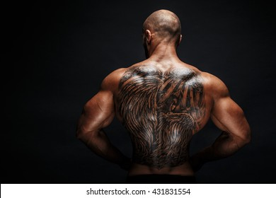 View of tattooed man's back