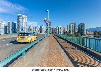 View of taxi on Cambie Street Bridge and Vancouver skyline, Vancouver, British Columbia, Canada, North America 16 September 2017