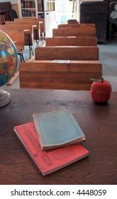 View From the Teacher's Desk - old school house - teacher's workbooks on desktop