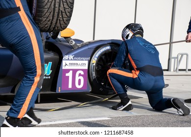 A view of a team changing tires on a racing car on pit lane at Tazio Nuvolari circuit during a competition. Italy-Cervesina 07 October 2018