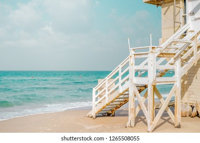 View of Tel Baruch beach in Tel Aviv, Israel. Baywatch cabin against mediterranean sea horizon.