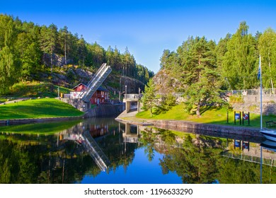 View of the Telemark Canal with old locks - tourist attraction in Skien, Norway