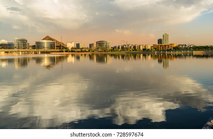 View of the Tempe city skyline and reflection in the Salt river  in Tempe