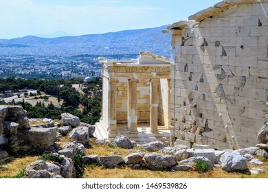 A view of the Temple of Athena Nika , which is a temple on the Acropolis of Athens, dedicated to the goddess Athena Nika.  The city of Athens is in the background