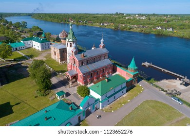 A view of the temples of the Staraya Ladoga Nikolsky Monastery on a sunny afternoon (aerial photography). Russia