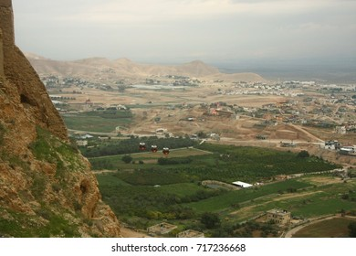 View from the Temptation Mountain Israel, Palestinian Territory, Jericho: View of Jericho from the Temptation Mountain. Rocky terrain.