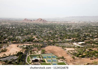 View of tennis courts and cityscape from Camelback mountain in Phoenix, Arizona