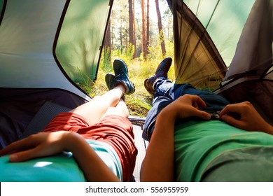 View from the tent. Couple resting in the tent