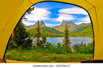 View from tent on mountain lake. Mountain lake view from camping tent. Camping tent at mountain lake. Mountain lake panorama from camping tent