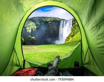 View from tent and Skogafoss waterfall in summer, Iceland