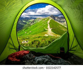 View from tent to Tatras in summer at sunset, Poland