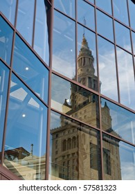 A view of the Terminal Tower reflected in the glass of an adjacent building