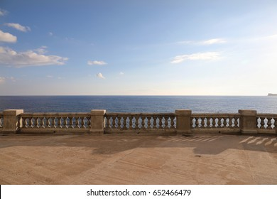 View from a terrace with old stone balustrade overlooking the sea