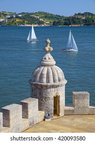 View of terrace with turret of Belem Tower castle over the Tagus river in Lisbon, Portugal.