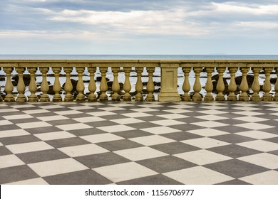 View of Terrazza Mascagni, in Livorno, Italy. It is an elegant waterfront terrace with a gazebo & benches offering panoramic sea and sunset views.