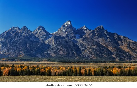 View of the Tetons mountains in the autumn time in Wyoming USA.