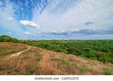 "View from the ""Teufelsberg"" (devil hill) over the forest ""Grunewald"" to downtown Berlin in the direction of the ""Funkkturm"" (radio tower) and the ""Fernsehturm"" (television tower) in Berlin, Germany."