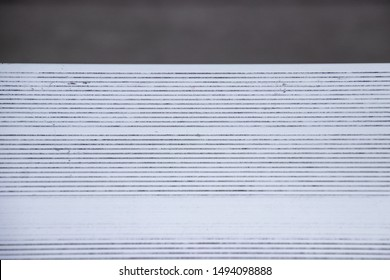View of texture of metal bench in bleachers of football, baseball or soccer stadium