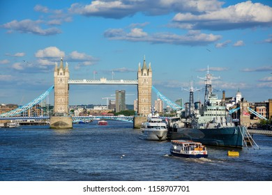 View of the Thames in London, England, with Tower Bridge, one of the symbols of the city, and HMS Belfast, a former Navy ship turned into museum. The river view was captured from London bridge