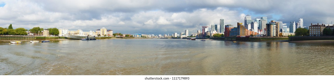 View of the Thames River from Greenwich a borough in London, England. Canary Warf, a busy financial area is on the right.