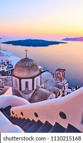 View of Thira town at sundown, Santorini, Greece