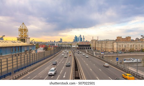 View of Third Transport Ring, busy highway in Moscow at sunset, urban landscape