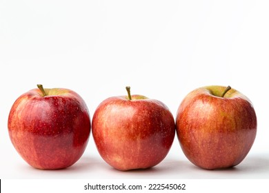 view of three red apples on white background