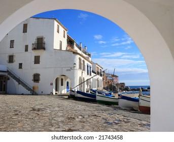 View through an arch of Calella de Palafrugell beach (Costa Brava, Catalonia, Spain)