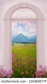 view through arched door, allgau landscape oberstdorf area with lychnis meadow