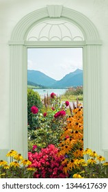 view through arched door, colorful flower bed at spa garden and alpine mountain lake bavaria