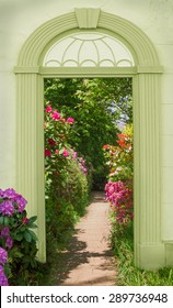 view through arched door, colorful blooming rhododendrons