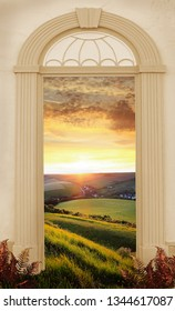 view through arched door, golden sunset over the hilly landscape