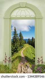 view through arched door, hiking trail in the bavarian mountains, martagon lily beside the path